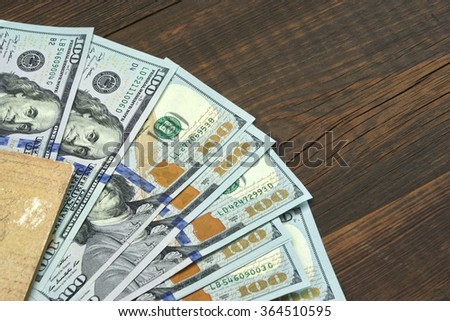 American One Hundred Dollar Bills In The  Notepad Top View On The Rough Wooden Table Background With Copy Space - stock photo