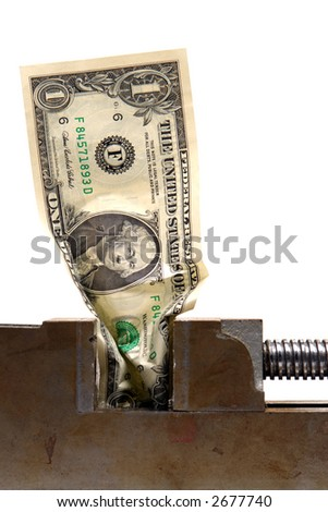 American one US dollar bill crushed in a vise over white as metaphor for a cash crunch recession - stock photo