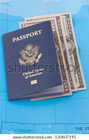 American passport  and dollars on map background for travel concept. - stock photo
