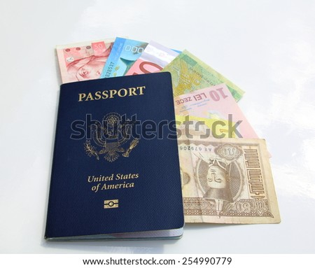 american passport and international currencies on a white background