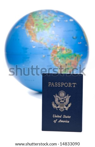 American passport in front of out of focus world globe, over white background - stock photo