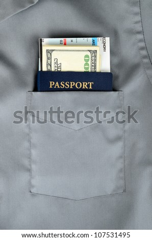 american passport with money and boarding pass in a front pocket of a shirt - stock photo
