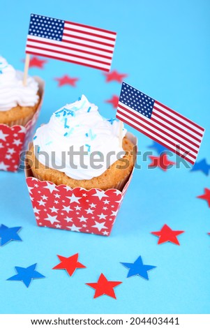 American patriotic holiday cupcakes on blue background - stock photo