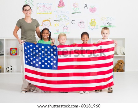 American preschool students and teacher holding a USA flag - stock photo