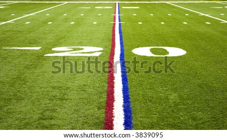 American Pro Football field on the 20 yard line with red white and blue stripe - stock photo