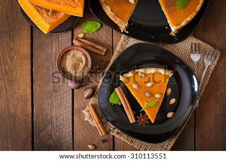American pumpkin pie with cinnamon and nutmeg. Top view - stock photo