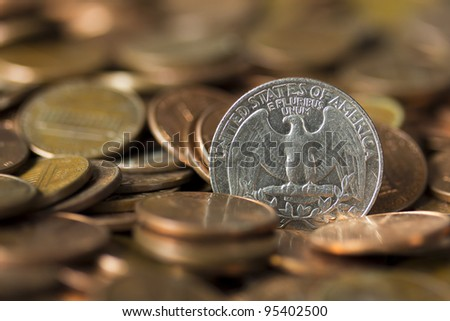 American Quarter of Dollar emerging from a pile of pennies. - stock photo