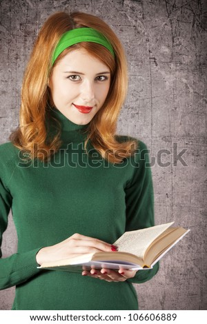 American redhead girl with book. Photo in 60s style. - stock photo