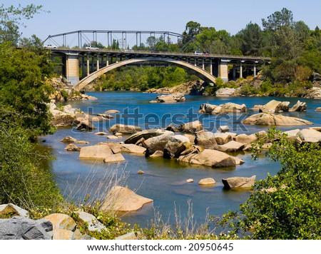 American River and Rainbow Bridge in Folsom - stock photo