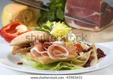 American sandwich w prosciutto and cheddar cheese - stock photo