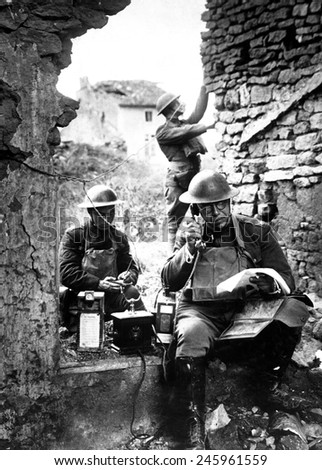 American signal officer of the 42nd Division, testing a telephone left behind by retreating Germans in the St. Mihiel salient. Essey, France. WWI. Sept. 19, 1918.