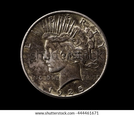 American silver dollar isolated on black, macro shot, top view