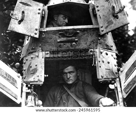 American skipper and gunner inside a British Whippet tank. The Whippet, a light and mobile tank, caused more German casualties than any other British tank of WWI. Northwest of Verdun, France. 1918. - stock photo