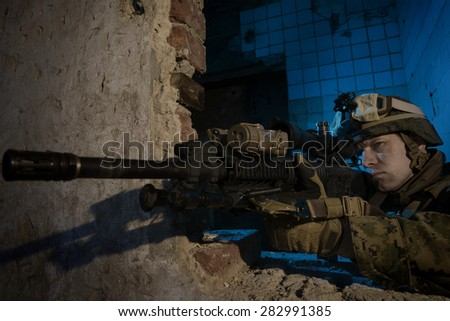 American soldier on the battlefield in an attack/defensive position.  - stock photo