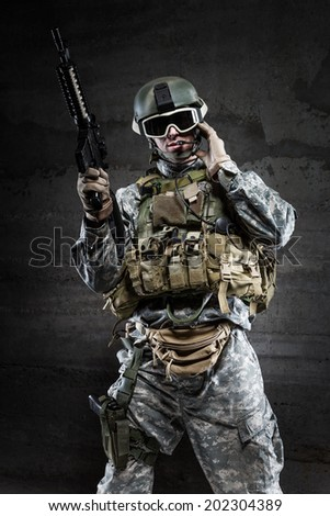 American Soldier wearing a mask and talking via radio