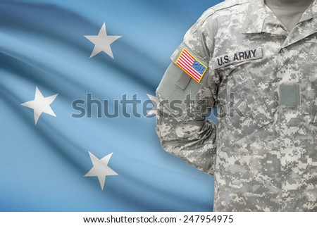 American soldier with flag on background - Federated States of Micronesia - stock photo