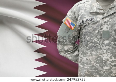 American soldier with flag on background - Qatar - stock photo