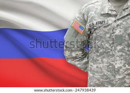 American soldier with flag on background - Russia - stock photo