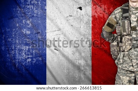 American soldier with France flag on background - stock photo