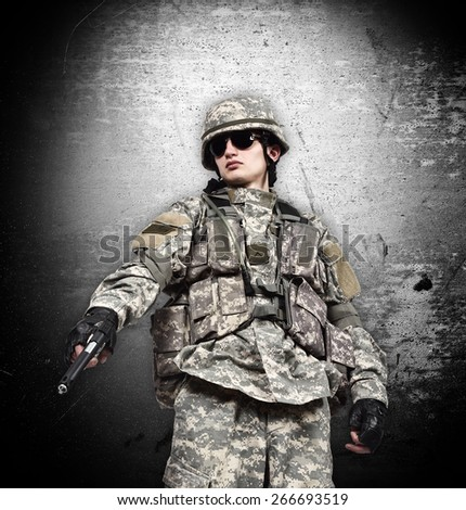 american soldier with gun on a black background - stock photo
