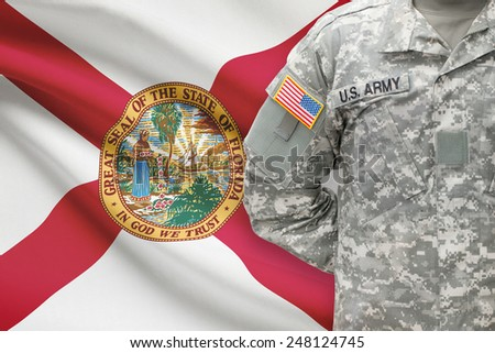 American soldier with US state flag on background - Florida - stock photo