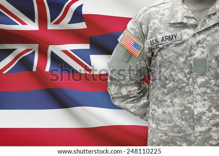 American soldier with US state flag on background - Hawaii - stock photo