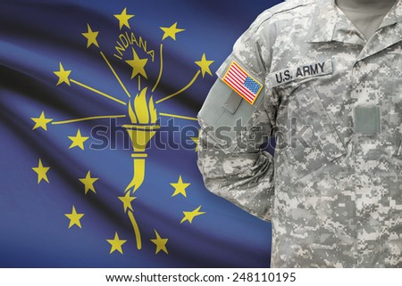 American soldier with US state flag on background - Indiana - stock photo