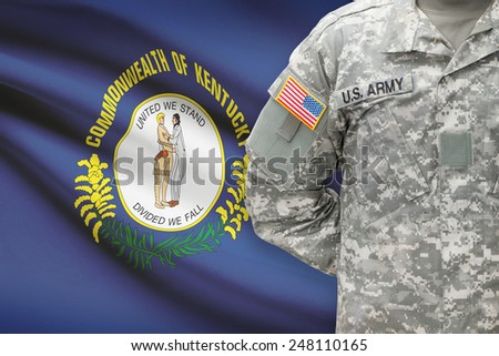 American soldier with US state flag on background - Kentucky - stock photo