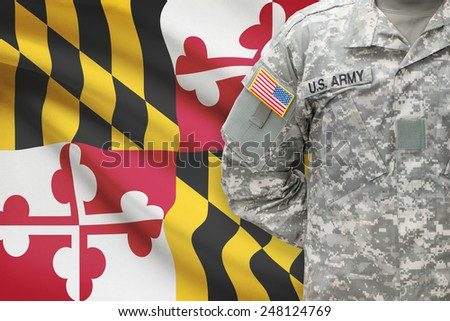 American soldier with US state flag on background - Maryland - stock photo