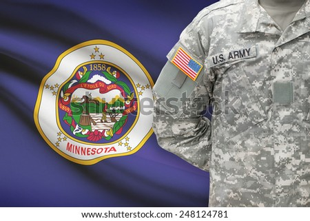 American soldier with US state flag on background - Minnesota - stock photo