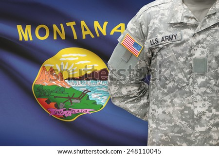 American soldier with US state flag on background - Montana - stock photo