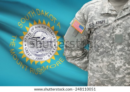 American soldier with US state flag on background - South Dakota - stock photo