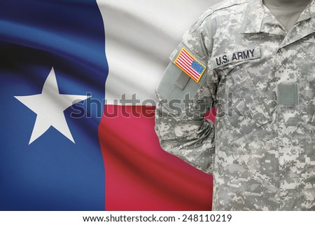 American soldier with US state flag on background - Texas - stock photo