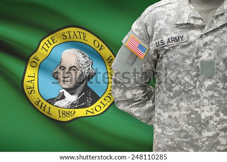 American soldier with US state flag on background - Washington - stock photo