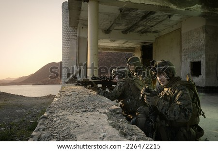 American soldiers guarding the building. Sniper attack the enemy from a secured position. Soldiers at Rest - stock photo