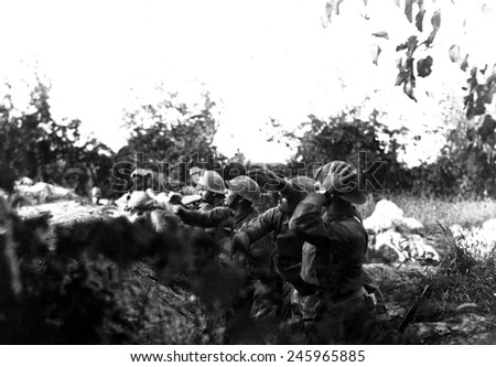 American soldiers in the Battle of the Piave River hurling hand grenades into Austrian trenches. Varage, Italy. WWI. Sept. 16, 1918. - stock photo