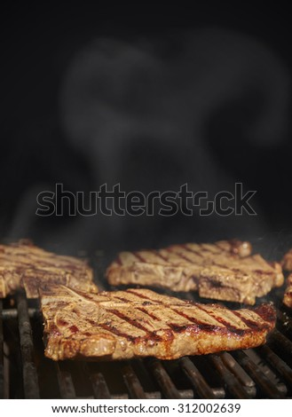 American style steak BBQ black background with copy space - stock photo