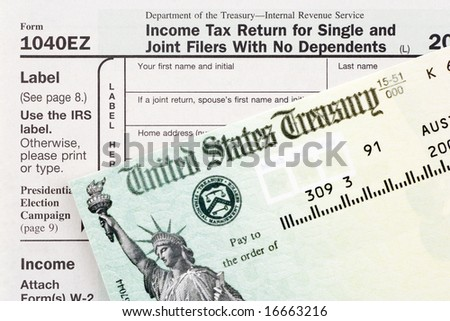 American Tax Form and an Refund Check - stock photo