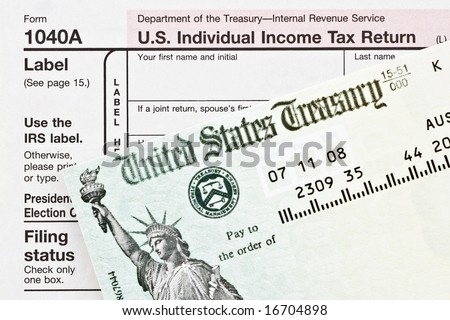 American tax form and refund check - stock photo