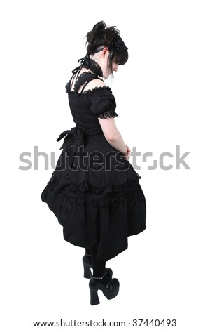 American teen girl wearing authentic Japanese style Gousurori or Gothic Lolita Fashion.  Clipping path. - stock photo