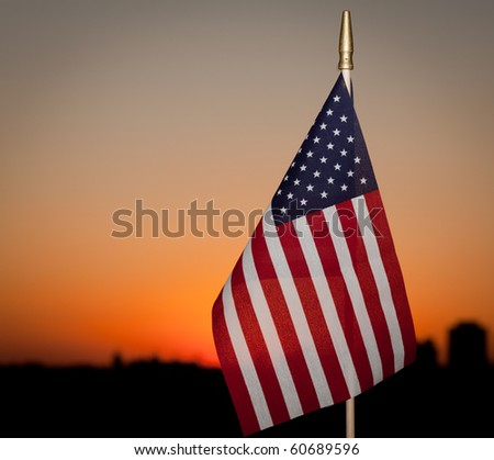 american toy flag at sunset as background - stock photo
