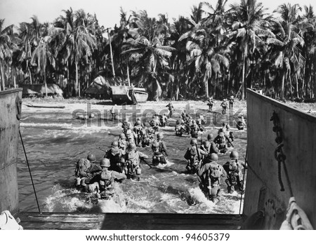 American troops storming the beaches during World War II - stock photo