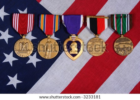 American War Medals on a USA red white and blue  Flag Background.