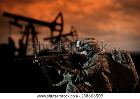 American way of democracy. Overthrow of government. U.S. Army soldiers preparing to attack/protect. U.S. Marine with a machine gun. - stock photo