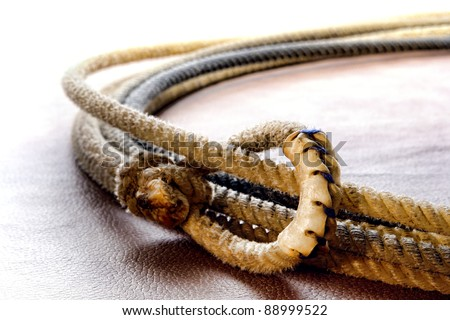 American West authentic rodeo cowboy lariat lasso hondo or honda noose with end loop rawhide speed burner detail - stock photo