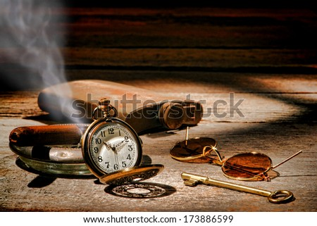 American West Legend frontier traveler vintage travel items with antique pocket watch and smoking cigar with sunglasses and room key on a wood table in old western hotel during a traveling rest stay - stock photo