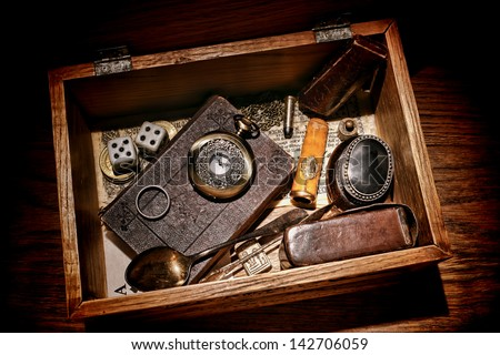 American West legend western pioneer memorabilia and souvenir collection with old bible and antique pocket watch with everyday object in a vintage keepsake wood box - stock photo