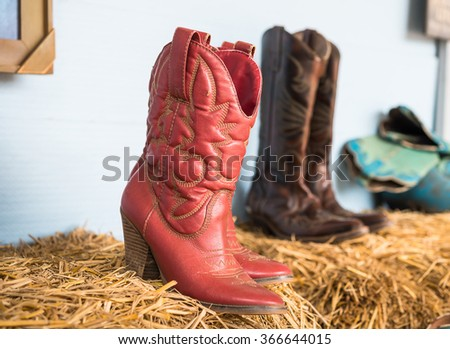 American West rodeo cowboy traditional leather working rancher roper boots with authentic Western riding spurs in a vintage - stock photo