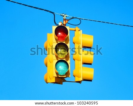 American yellow traffic lights isolated on blue sky - stock photo