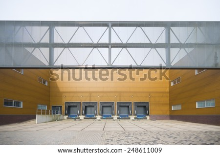 AMERSFOORT, NETHERLANDS - SEPTEMBER 28, 2014: Loading docks belonging to Extron Europe, a manufacturer of products for integrating computer, video, and audio into presentation displays - stock photo